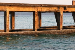 Cement bridge in the sea Do not use damaged or walk through.