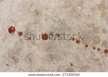 cement floor with a drop of...