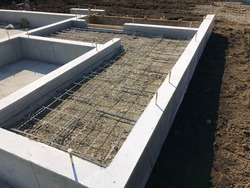 Cement foundation of house in construction site  on land. The constructed to withstand an earthquake disaster prevention. Safety and quickly to building complete. Housing structure style of japan.