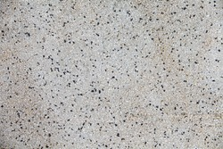 Cement mixed small gravel stone wall or floor texture background,The Dust Texture. Abstract dense splash texture. Random pebble gravel oval elements seamless pattern.