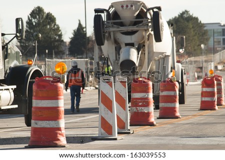 Cement mixer truck at construction site.