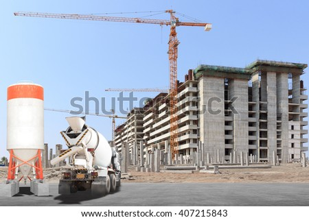 Cement mixer truck with precast concrete piles at building under construction