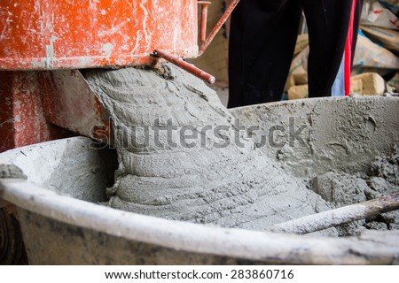 Cement or mortar is inside cement mixer. Cement or mortar is mix