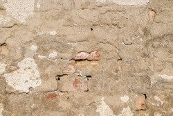 Cement plastered wall with cracks as background
