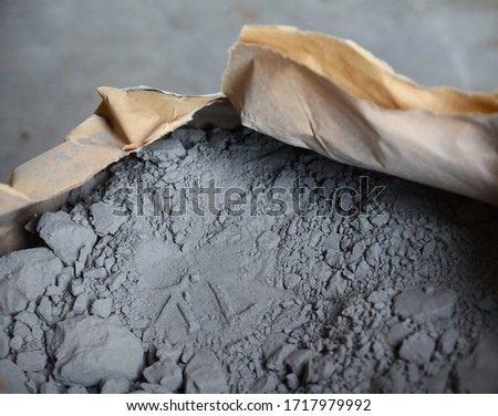 Cement powder in bag before mix. Concrete texture background Foto stock ©