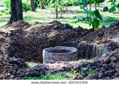 Cement septic tank for waste water under construction. #605165306