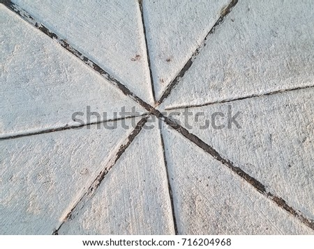 cement sidewalk with intersecting lines #716204968