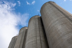 Cement silo towers, represents data silos in computer science, which isolate data since the only access gate to the data is a single application
