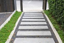 Cement stairs way in the garden to entrance door.