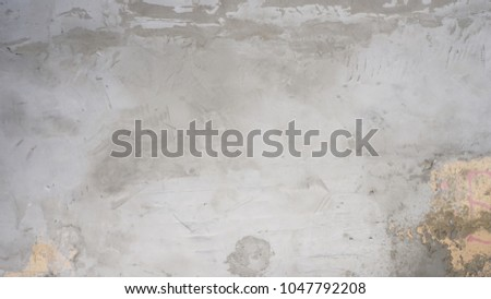 cement textured background wall with apricot painted layer and black scratches titles concrete #1047792208