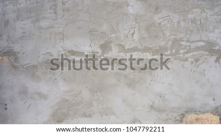 cement textured background wall with apricot painted layer and black scratches titles concrete #1047792211