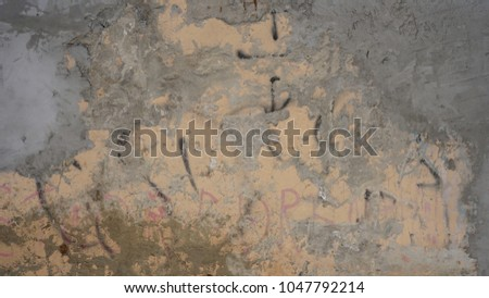 cement textured background wall with apricot painted layer and black scratches titles concrete #1047792214
