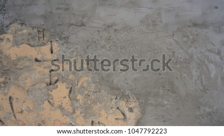 cement textured background wall with apricot painted layer and black scratches titles concrete #1047792223