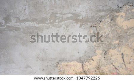 cement textured background wall with apricot painted layer and black scratches titles concrete #1047792226