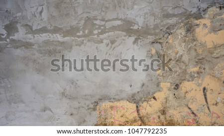 cement textured background wall with apricot painted layer and black scratches titles concrete #1047792235
