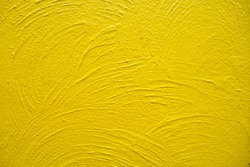 Cement wall painted in yellow and golden tone with rough surface and texture for background and decoration. Cool banner on page and cover
