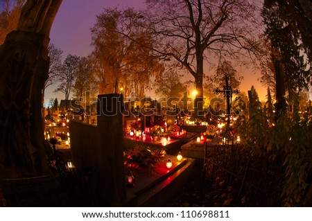 cemetary decorated with candles ...