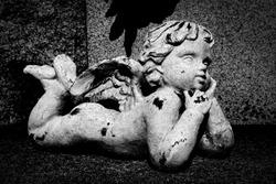 Cemetery cherub in old graveyard
