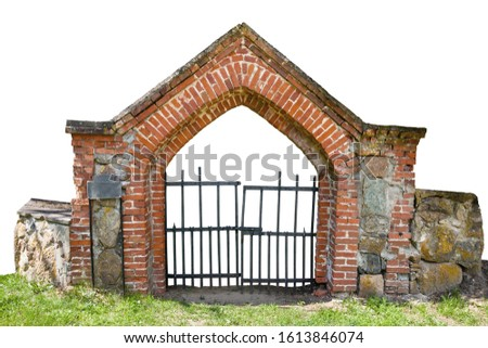 Cemetery gate made of red bricks isolated on white background stock photo