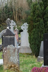 Cemetery in rural Ireland featuring headstones and celtic cross gravestones