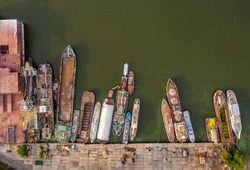 Cemetery of old, decommissioned ships. Water area of the river port of Dnepropetrovsk, Ukraine. Dnieper river waters. Top view.