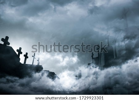 Cemetery or graveyard in the night with dark sky and white clouds. Haunted cemetery. Spooky and scary burial ground. Horror scene of graveyard. Funeral concept. Sadness, lament and death background. Stockfoto ©