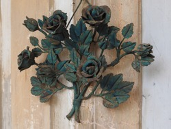 Cemetery, ornament. Metal flowers. Roses.