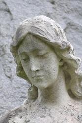 Cemetery Sculpture of Contemplative Woman