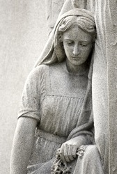 Cemetery statue of Mary Mourning closeup, copy space, Location Mount Olivet Cemetery in Nashville, TN
