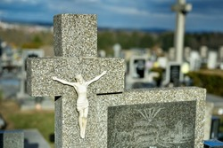 Cemetery with tombstones in the shape of a cross, angels. Many decorated graves