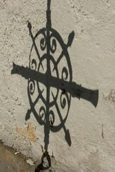 Cemetry churchyard shadow of a tomb cross