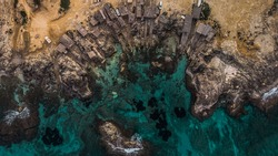 Cenital picture on aerial view taken with a drone in Es Calo de Sant Agusti en Formentera, Spain. Sand in the beach coast is visible with pristine water all together