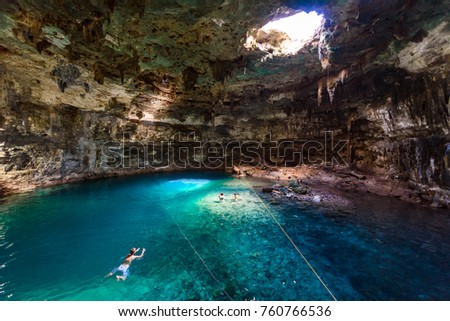 Shutterstock Cenote Samula Dzitnup near Valladolid, Yucatan, Mexico - swimming in crystal blue water