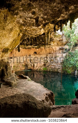 Cenote Zaci in Valladolid Mexico on Yucatan peninsula. A natural limestone sinkhole where people swim in the middle of the city.