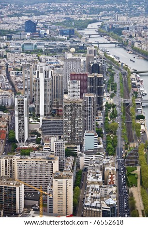 Center of Paris from the heights. View from the Eiffel Tower on the river Seine. Modern architecture.