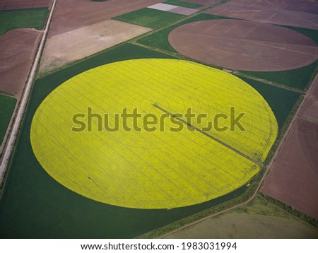 Center pivot irrigation system on a yellow rapeseed field aerial drone view Photo stock ©