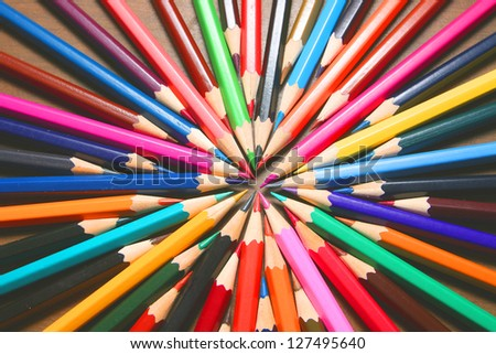 Center symbol of vector business team one goal, one aspiration and desire  bunch of colored pencils isolated on white background