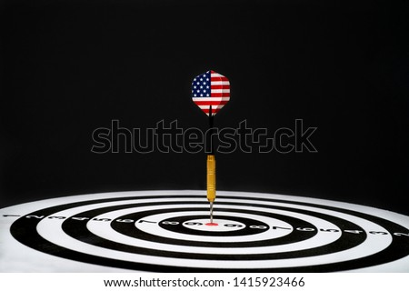 Center target of darts isolated on a black background #1415923466