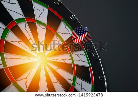 Center target of darts isolated on a black background #1415923478