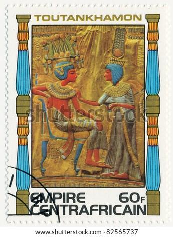 CENTRAL AFRICAN EMPIRE - CIRCA 1978: A stamp printed in Central African Empire shows King and queen black panel of throne, series Tutankhamun, circa 1978