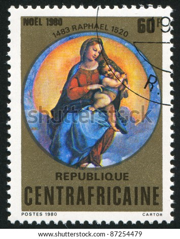CENTRAL AFRICAN REPUBLIC 1980: A stamp printed by Central African Republic, shows Virgin and Child, by Raphael, circa 1980