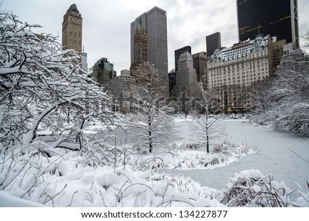 Central after snow storm with view of Plaza hotel