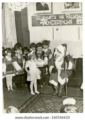 CENTRAL BULGARIA, BULGARIA - CIRCA 1980 - In kindergarten, Santa Claus (Papa Frost or Papa Noel) visited the children circa 1980