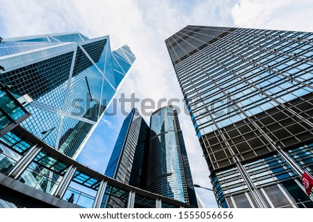 Central, Hong Kong -July 17, 2019: low angle view of modern office block buildings in Hong Kong. #1555056656