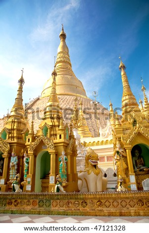 Central pagoda surrounded by hundreds of smaller shrines of Shwedagon pagoda, Yangon, Myanmar.