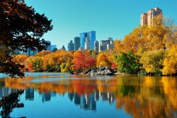Central Park Autumn and buildings reflection in midtown Manhattan New York City