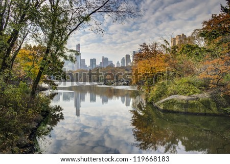 Central Park, New York City at the lake in late autumn with clouds in sky