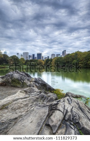 Central Park, New York City citiscape on lake on stone ridge - stock photo
