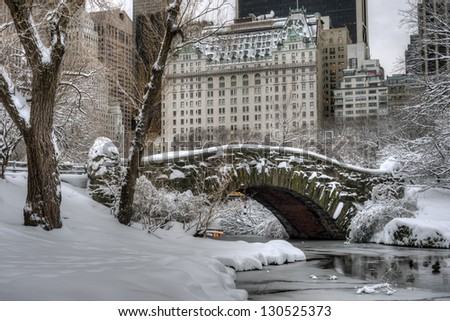 Central Park, New York City Gapstow bridge after snow storm - stock photo