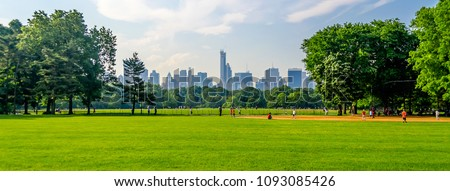 Central Park on a sunny day and a beautiful contrast with skyscrapers and buildings, Manhattan, New York City, USA #1093085426